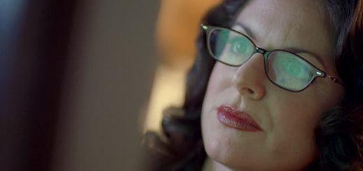 woman staring at screen